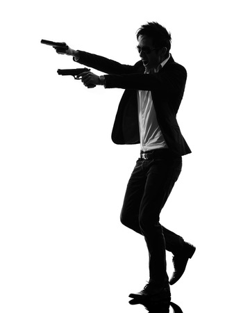 one asian gunman in silhouette isolated white background