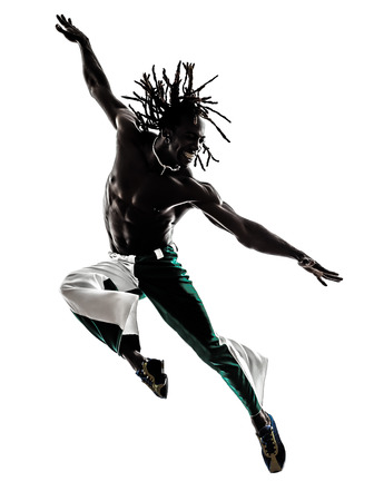 one black man dancer dancing jumping on white background photo