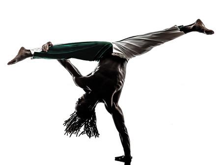 one black man dancer dancing capoeira on white background photo