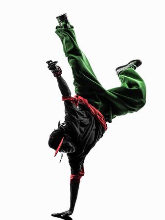 bailarin hombre: uno hip hop acrobático bailarín de la rotura breakdance joven pino silueta fondo blanco Foto de archivo