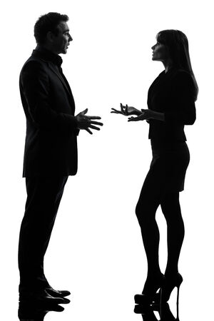 one caucasian business couple woman man in silhouette studio isolated on white background photo