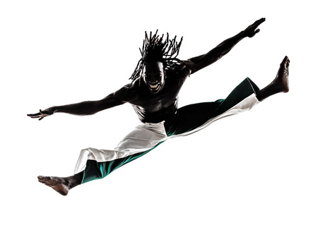 one black man dancer dancing capoeira on white background photo