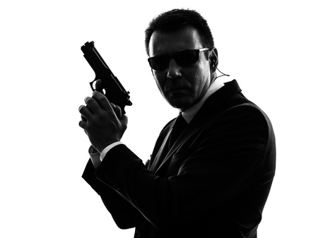 secret service: one secret service security bodyguard agent  man in silhouette  on white background