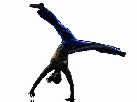 one caucasian woman capoeira dancer dancing in silhouette studio isolated on white background photo