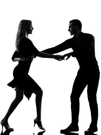 una mujer, caucásico, hombre pareja de baile bailarines del rock salsa en la silueta del estudio aislada en el fondo blanco Foto de archivo