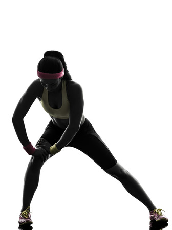 one woman: one woman exercising fitness workout in silhouette on white background