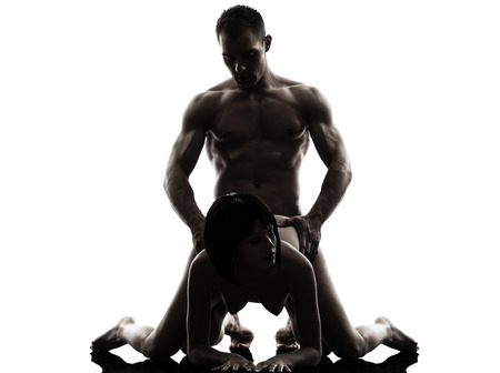 one caucasian couple man woman sexual kamasutra posture love activity in silhouette studio on white background Stock Photo