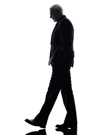 One Caucasian Senior Business Man walking Silhouette White Background photo