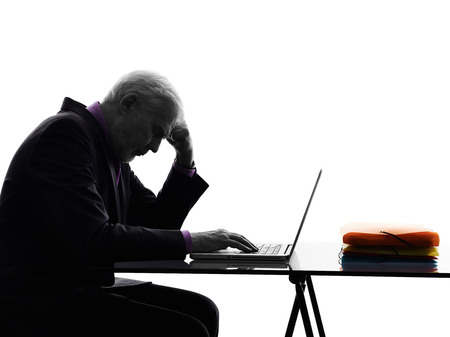 One Caucasian Senior Business Man computing laptop Silhouette White Background photo