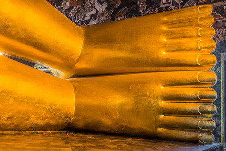 reclining buddha feet at Wat Pho temple bangkok thailand photo
