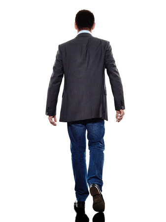 1 person: one caucasian business man walking rear view  in silhouette  on white background