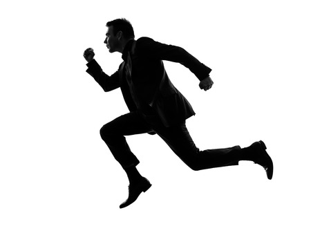 man side view: one caucasian business man running in silhouette  on white background