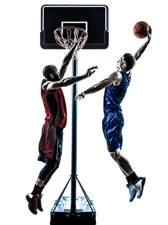 basketball shot: two men caucasian and african basketball players competition jumping dunking in silhouette isolated white background