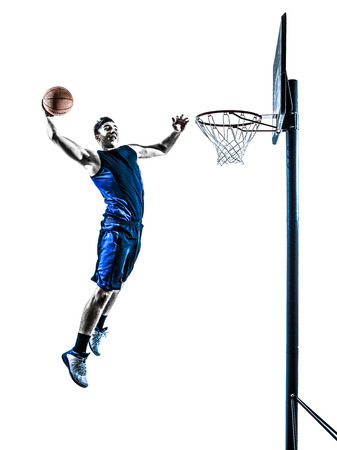 one caucasian man basketball player jumping dunking in silhouette isolated white background photo