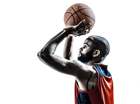 a basketball player: one african man basketball player free throw in silhouette isolated white background Stock Photo