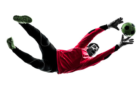 in action: one caucasian soccer player goalkeeper man catching ball in silhouette isolated white background