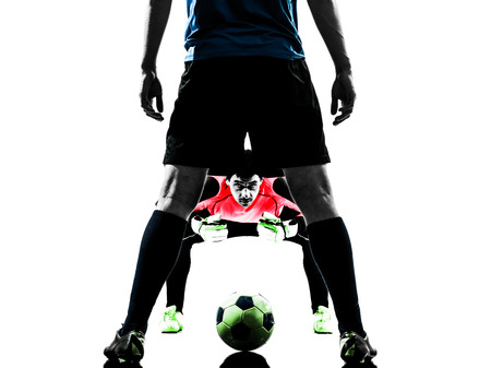 two caucasian soccer player goalkeeper men face to face competition in silhouette isolated white background photo
