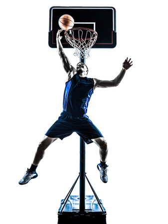 one caucasian man basketball player jumping throwing in silhouette isolated white background photo