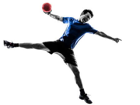 one young man: one caucasian young man exercising handball player in silhouette studio on white background