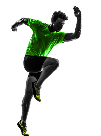 sprinting: one caucasian man young sprinter runner running in silhouette studio on white background Stock Photo