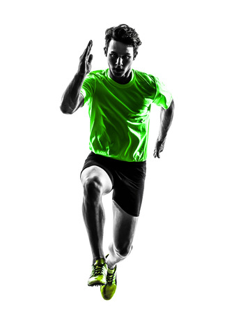 athleticism: one caucasian man young sprinter runner running in silhouette studio on white background Stock Photo