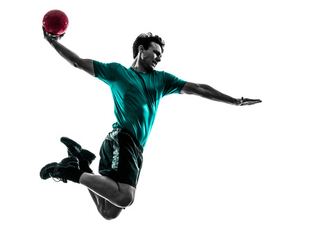 handball: one  young man exercising handball player in silhouette studio on white background