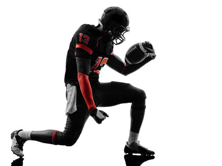one american football player joyful celebrating in silhouette shadow on white background photo