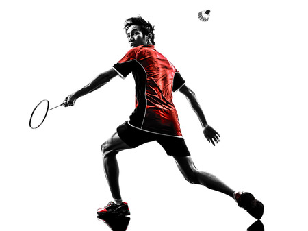 badminton: one asian badminton player young man in silhouette isolated white background