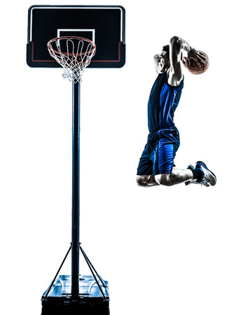 one  man basketball player jumping dunking in silhouette isolated white background photo