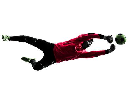 portero: un jugador de fútbol portero hombre perforando la bola en silueta aislado fondo blanco Foto de archivo