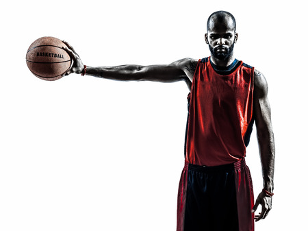 jerseys: one african man basketball player holding ball in silhouette isolated white background