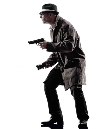 mystery man: one detective man criminals investigations  investigating crime in silhouettes on white background