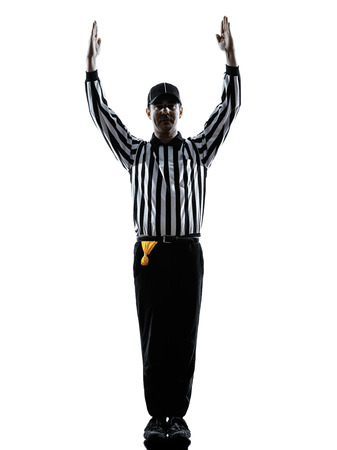 american football scheidsrechter touchdown gebaren in silhouetten op witte achtergrond Stockfoto