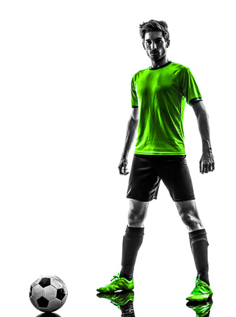 one soccer football player young man standing defiance in silhouette studio on white background photo