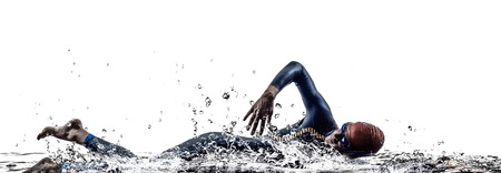 triathlon: man triathlon iron man athlete swimmers swimming in silhouettes on white background Stock Photo