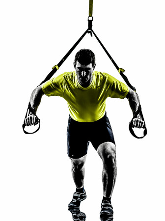 one  man exercising suspension training trx on white