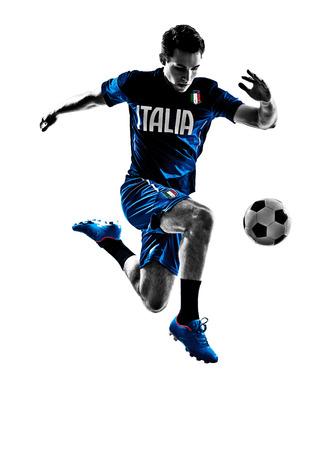 joueurs de foot: un italien joueurs de football homme saut � jouer au football dans silhouettes blanches Banque d'images
