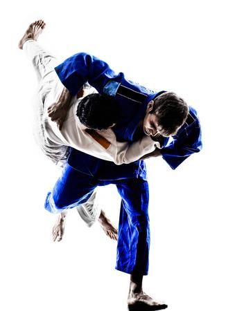 2 つの judokas 戦闘機が白のシルエットで男性の戦い 写真素材