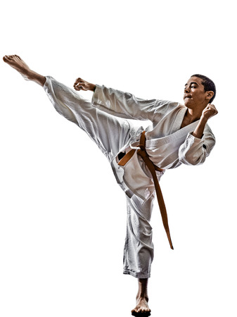 one karate katana training  teenagers kid  isolated on white  photo