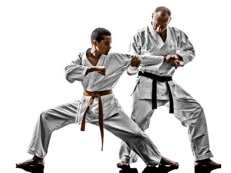 sensei: two karate men sensei and  teenager students teacher teaching isolated on white background
