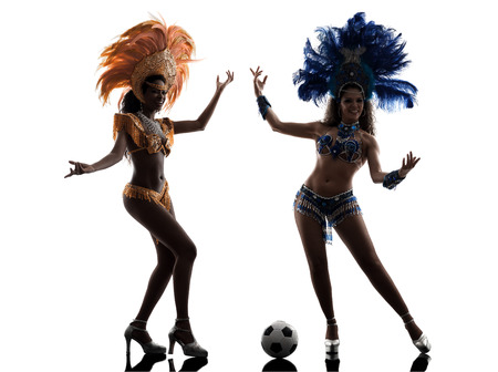 two women samba dancer playing soccer silhouette on white  photo