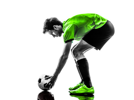 one soccer football player young man preparing free kick in silhouette studio on white  photo
