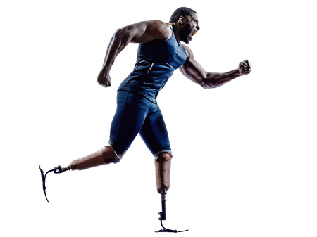 one muscular handicapped man runners sprinters  with legs prosthesis in silhouettes on white  photo
