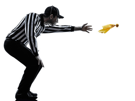 penalty: american football referee gestures in silhouettes on white  Stock Photo