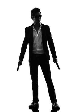 shooters: one asian gunman killer standing in silhouette isolated white background Stock Photo