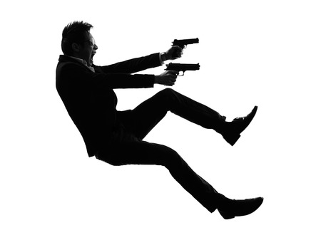 shooters: one asian gunman killer jumping shooting in silhouette isolated white background