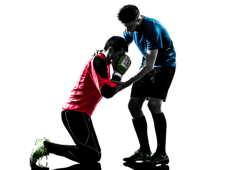 fairplay: two  soccer player goalkeeper men competition in silhouette isolated white background Stock Photo