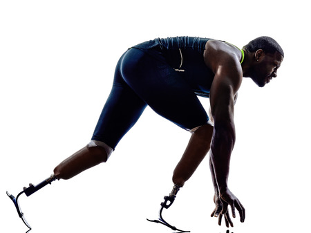 disabled sports: one muscular handicapped man runners sprinters  with legs prosthesis in silhouettes on white background