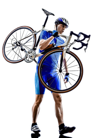 cyclist carrying bicycle  in silhouettes on white background photo