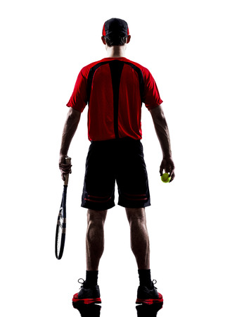 one man: one man tennis players back rear view in silhouettes isolated on white background
